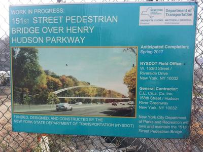 Sign describing construction of pedestrian bridge